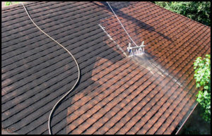 Roof being power washed.