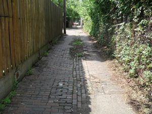Brick pathway with replaced bricks